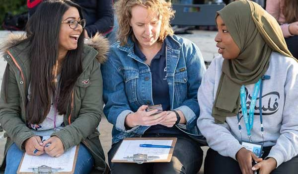 Image of 3 ladies from different cultures conversing